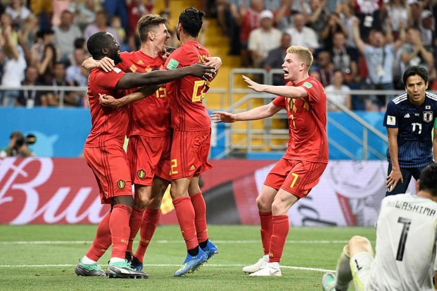 Belgium players celebrate during the 2018 World Cup round of 16 football match between Belgium and Japan at the Rostov Arena in Rostov-On-Don, on July 2, 2018.