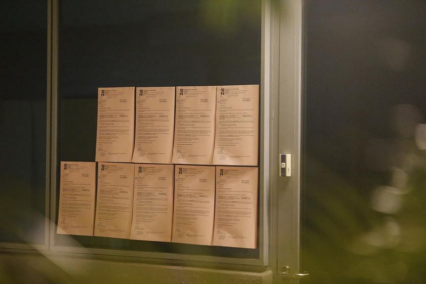 Nine stacks of offence notices pasted on oBike's now defunct office window for failure of removal of illegally parked bicycles and obstruction of bicycles at common areas.