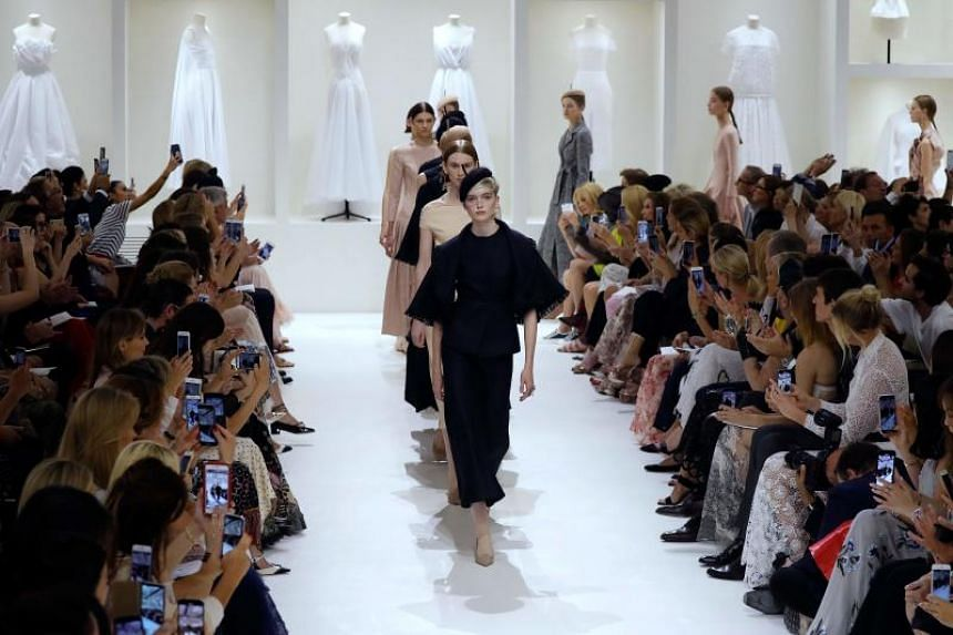 Models presenting creations by Christian Dior at the end of the 2018-2019 Fall/Winter Haute Couture collection fashion show in Paris, on July 2, 2018.