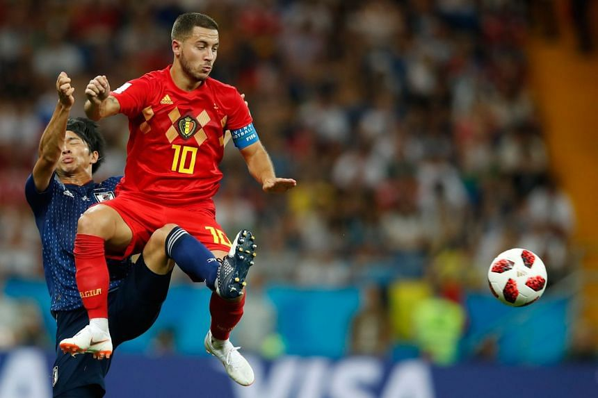 Belgium's forward Eden Hazard (right) fights for the ball with Japan's midfielder Gaku Shibasaki during the Russia 2018 World Cup round of 16 football match between Belgium and Japanat the Rostov Arena in Rostov-On-Don on July 2, 2018.