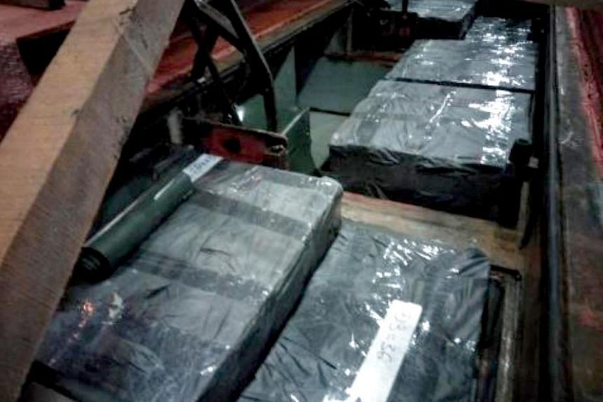 More than 7,000 cartons of contraband cigarettes were seized from two cargo trucks at the Tuas arrival checkpoint, on June 28, 2018.