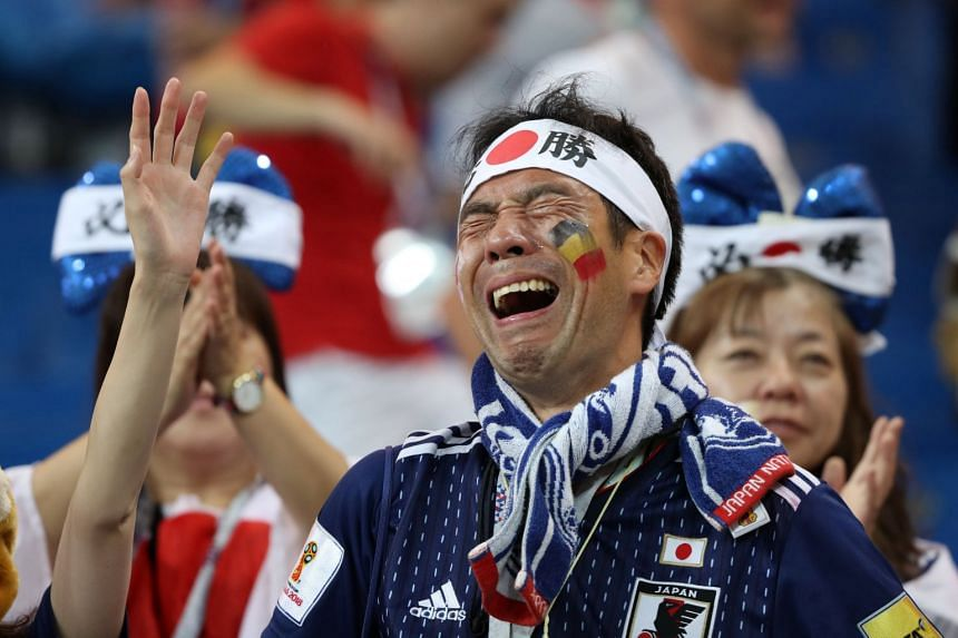 A Japanese fan looking dejected following Japan's loss to Belgium at the 2018 World Cup early on July 3, 2018.