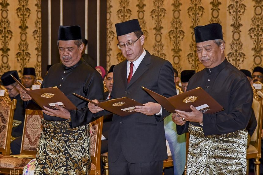 New Malaysian Defense Minister Mohamad Sabu (left), Finance Minister Lim Guan Eng and Home Affairs Minister Muhyiddin Yassin during a swearing in ceremony at the National Palace in Kuala Lumpur, on May 21, 2018.