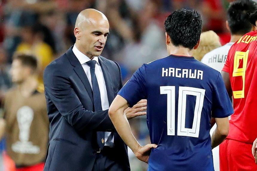 Belgium coach Roberto Martinez (left) greeting Japan's Shinji Kagawa following the World Cup clash between the two nations, on July 3, 2018.