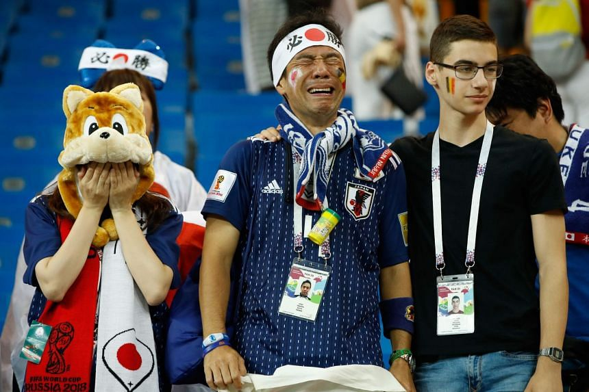 Japan's fans react at the end of the Russia 2018 World Cup round of 16 football match between Belgium and Japan at the Rostov Arena in Rostov-On-Don on July 2, 2018.