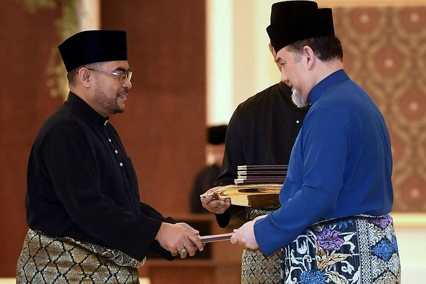 Islamic Affairs Minister Mujahid Yusof Rawa (left) will have to tread carefully on how to tackle the religious divide following his appointment.