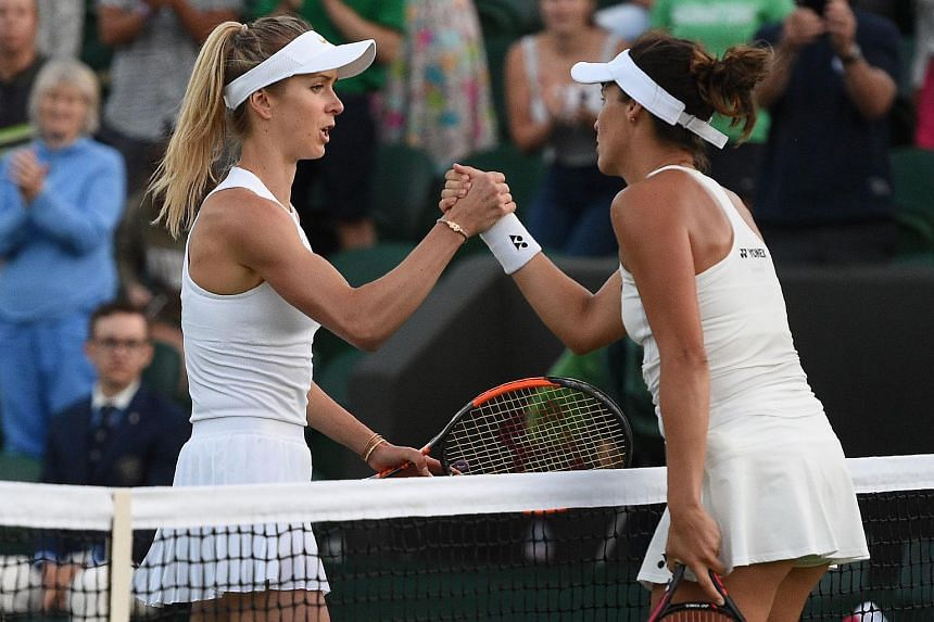 Germany's Tatjana Maria (right) shaking hands with Ukraine's Elina Svitolina at the 2018 Wimbledon Championships, on July 2, 2018.