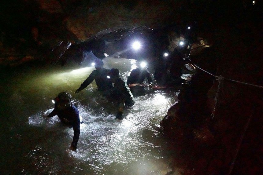 Thai Navy Seals navigating a flooded section of Tham Luang cave on July 1, 2018.
