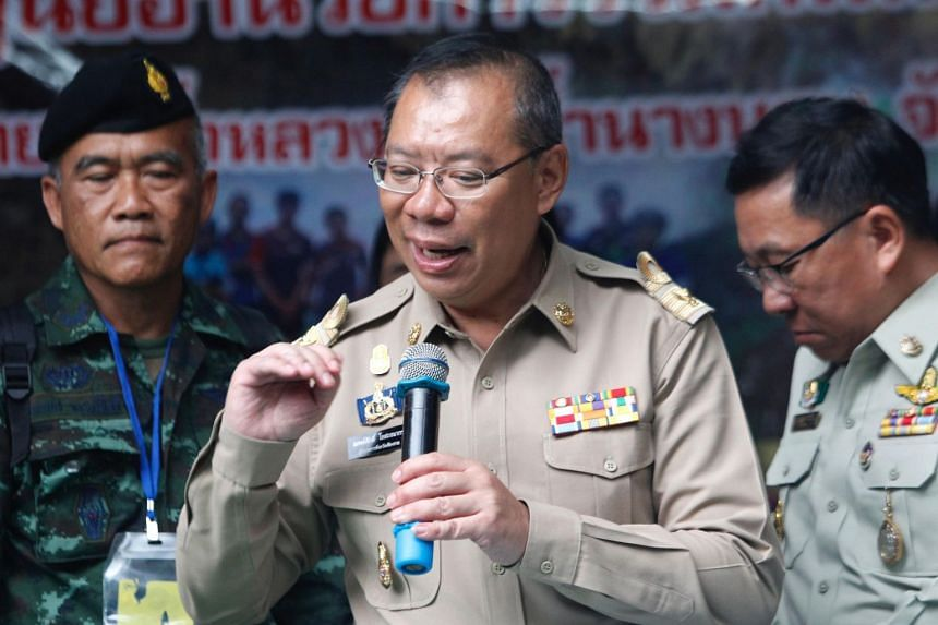 Thailand's Chiang Rai provincial Governor Narongsak Osatanakorn (centre) speaking at a press conference on the rescue operation of children from a youth football team and their coach, on July 3, 2018.