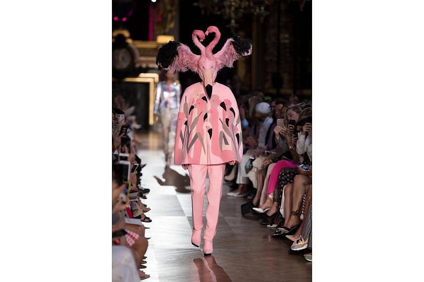 Schiaparelli adopts an animal theme, incorporating shocking pink and feathered flamingo headdresses (above).