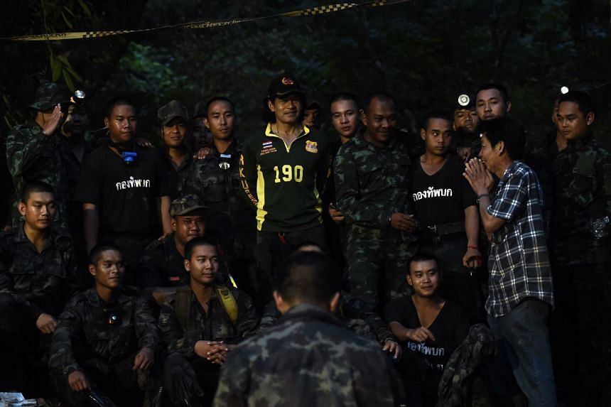 The father of a missing football player thanks soldiers near Tham Luang cave after it was reported that all members of the team and their coach were alive, on July 3, 2018.