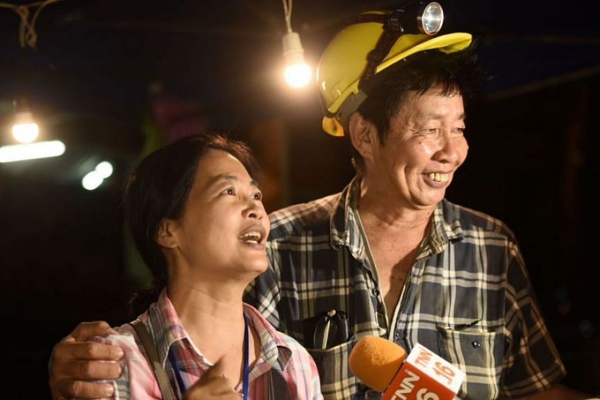 Relieved family members celebrating while camping out near Than Luang cave after news that all members of a children's football team and their coach were alive, on July 2, 2018.