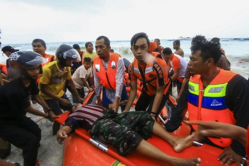 Indonesian rescuers evacuate a victim of a sinking ferry off the coast of Selayar island, in South Sulawesi, Indonesia.
