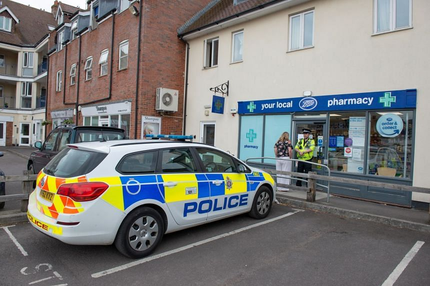 Police outside a Boots Pharmacy which has been closed in relation to two people who were found unconscious following exposure to an unknown substance,