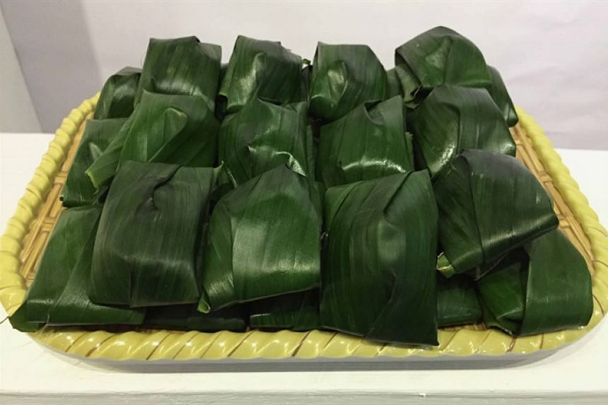 Black banh is a sweet candy wrapped in banana leaves.