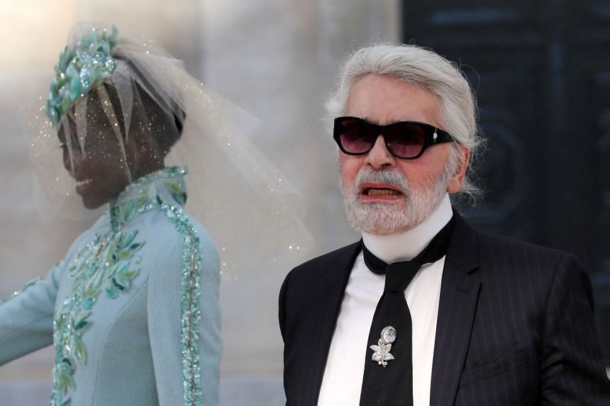 German designer Karl Lagerfeld appears at the end of his Haute Couture Fall/Winter 2018/2019 collection show for fashion house Chanel.