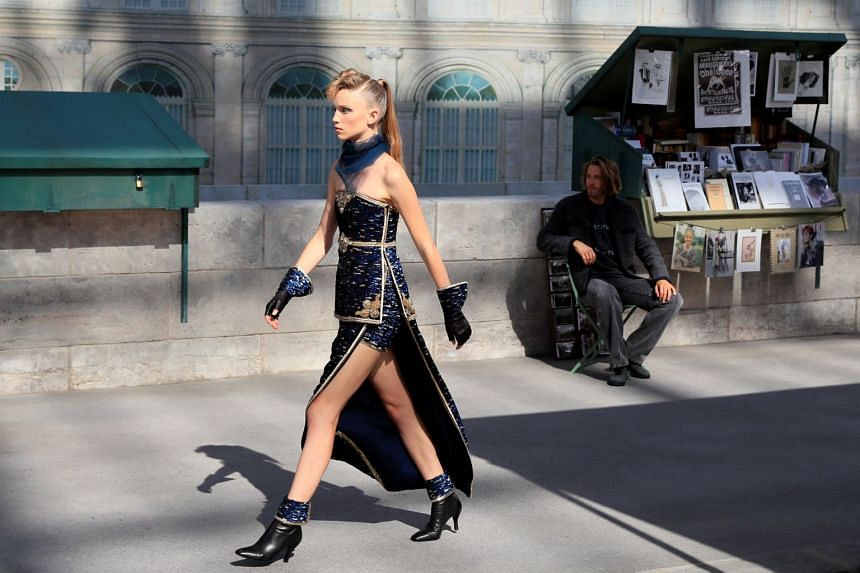 A model presents a creation by German designer Karl Lagerfeld as part of his Haute Couture Fall/Winter 2018/2019 collection show for Chanel.