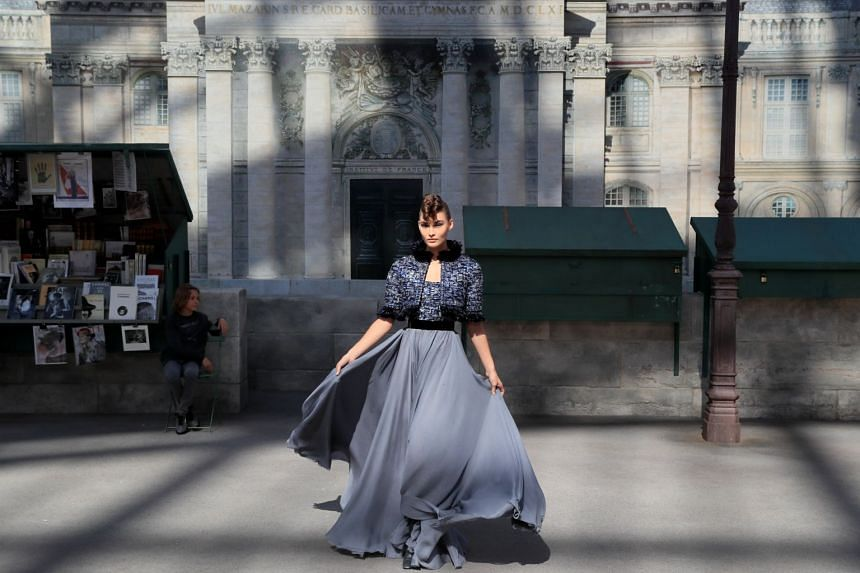 A model presents a creation by German designer Karl Lagerfeld as part of his Haute Couture Fall/Winter 2018/2019 collection for Chanel.