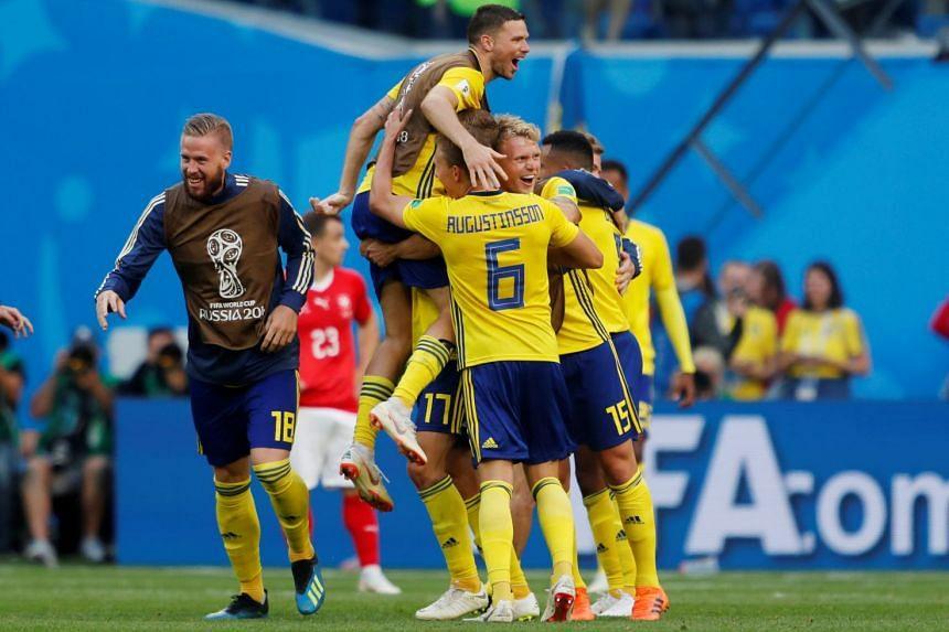 Sweden's Oscar Hiljemark and team mates celebrate after the match.