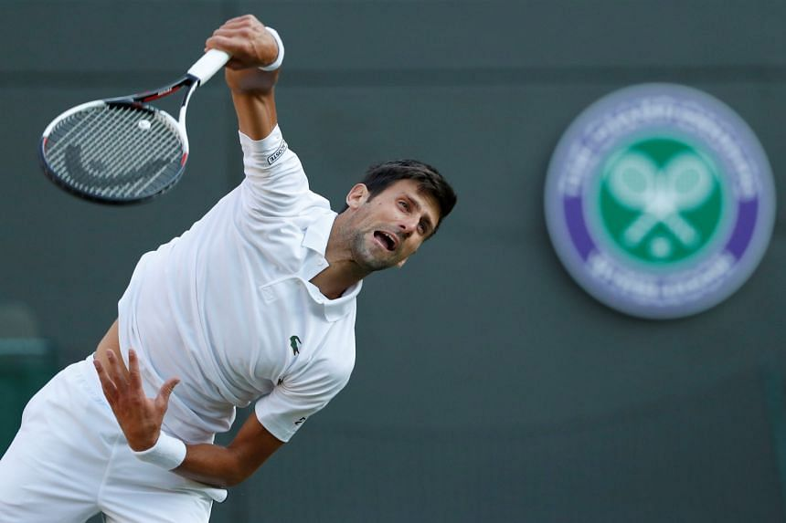 Djokovic serves during his first round match against Tennys Sandgren of the US.