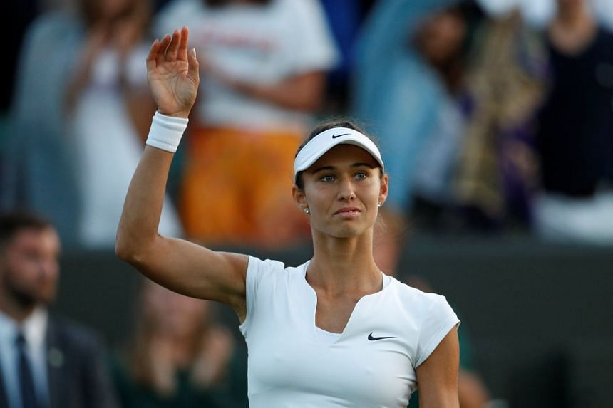 Russia's Vitalia Diatchenko celebrates winning the first-round match against Sharapova.