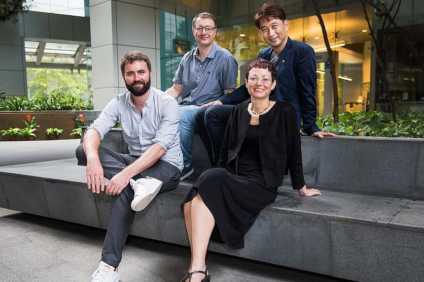 Co-founders of Immunoscape, (clockwise from front right) Dr Alessandra Nardin, Dr Michael Fehlings, Dr Evan Newell and Mr Ng Choon Peng.