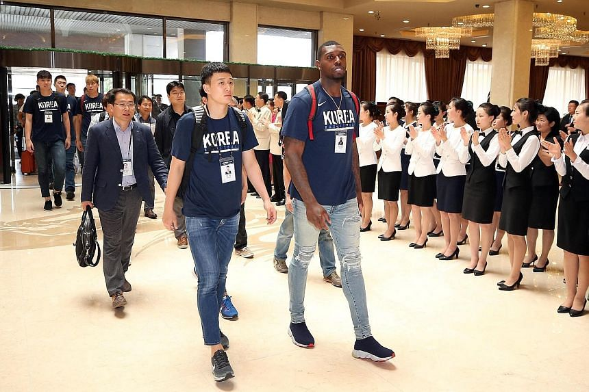 """Members of the South Korean men's basketball team being welcomed at the Koryo hotel in Pyongyang yesterday. Unification Minister Cho Myoung-gyon said he hoped the games would """"further enhance peace on the Korean peninsula""""."""