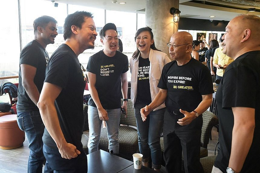 Collaborators at the launch of the Singapore Kindness Movement's Be Greater campaign yesterday included (from left) singers Jack and Rai, emcee Royce Lee, magician Ning Cai, SKM general secretary William Wan, and Starbucks Singapore general manager P