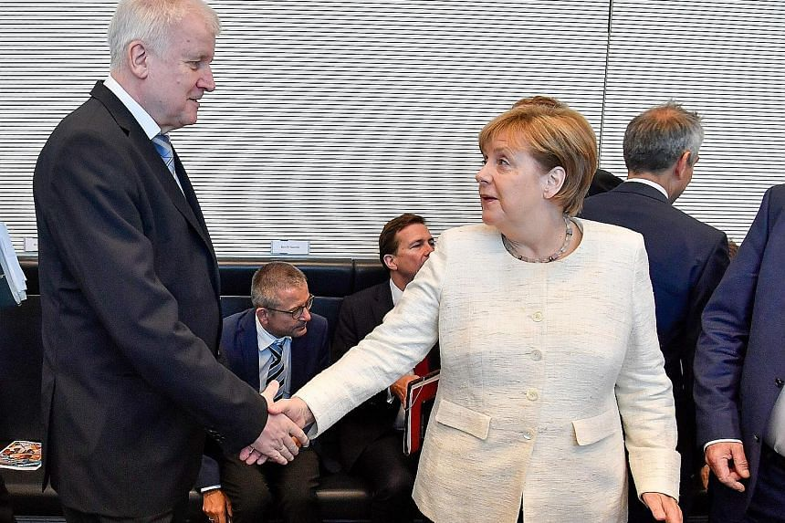 """German Interior Minister Horst Seehofer and Chancellor Angela Merkel have agreed to tighten border controls and set up closed """"transit centres"""" to allow the speedy processing of asylum seekers."""