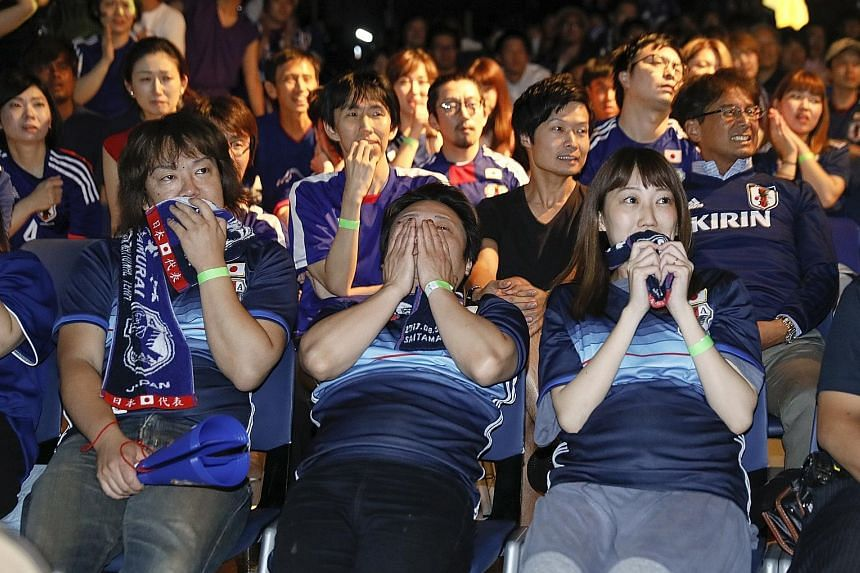 Japanese soccer fans at a public viewing venue in Tokyo were left devastated early yesterday after their team lost to Belgium in a World Cup round-of-16 match. The Samurai Blue looked on track to reach their first quarter-final after going 2-0 ahead,