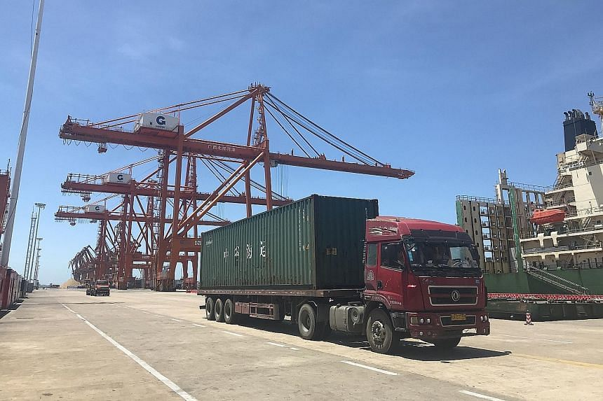 The Beibu-Gulf-PSA International Container Terminal, which Deputy Prime Minister Teo Chee Hean visited yesterday as part of his tour of nodes along the Southern Transport Corridor. DPM Teo meeting Guangxi autonomous region chairman Chen Wu in Nanning