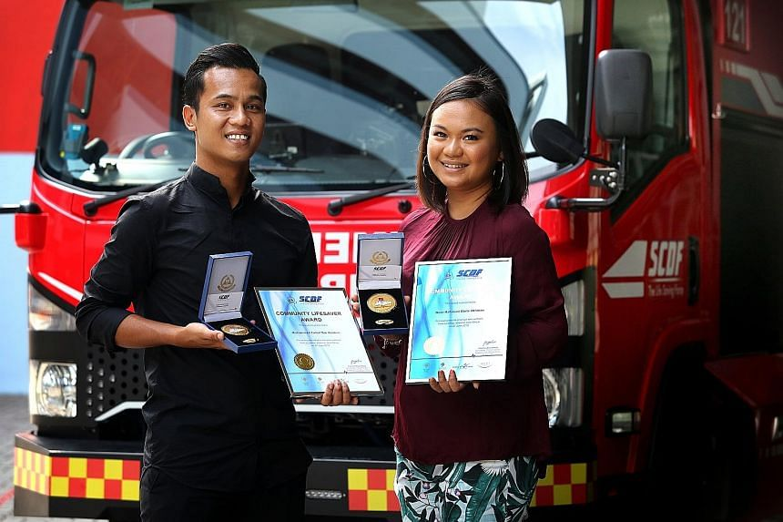Mr Muhammad Faizal Ibrahim and his girlfriend Noor Hafawati Othman with their Community Lifesaver Awards from SCDF, given in recognition of their public spiritedness.