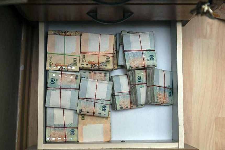 Besides $1.25 million in cash, computers, cellphones and documents were also seized by the police.