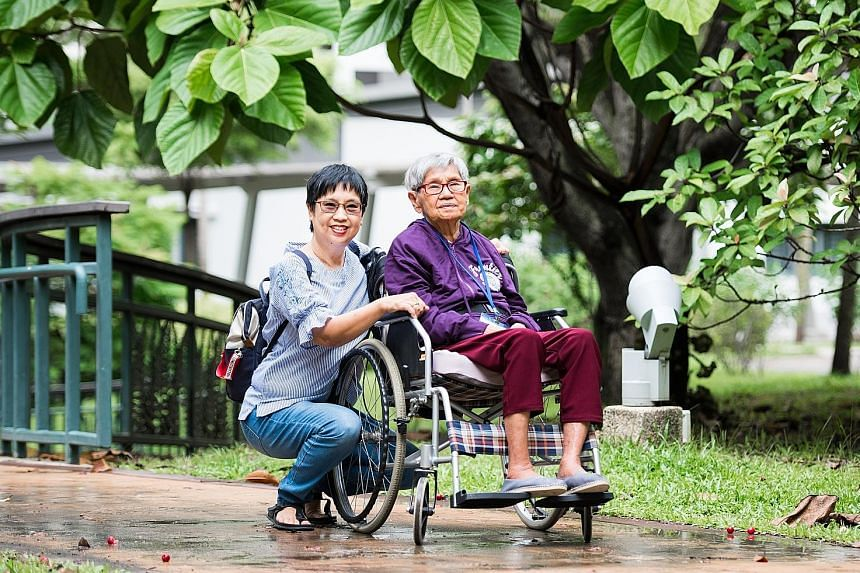 The Medisave move will help Madam Quek Pong, seen here with her daughter Sarah Liew. Madam Quek gets $300 a month from ElderShield now, but her children have to pay the rest of her expenses - about $900 a month.
