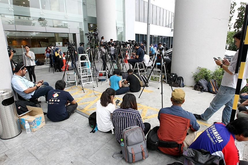 Members of the media outside the MACC headquarters in Putrajaya yesterday. Datuk Seri Najib Razak was taken to the anti-graft agency in an unmarked vehicle, escaping the glare of the media.