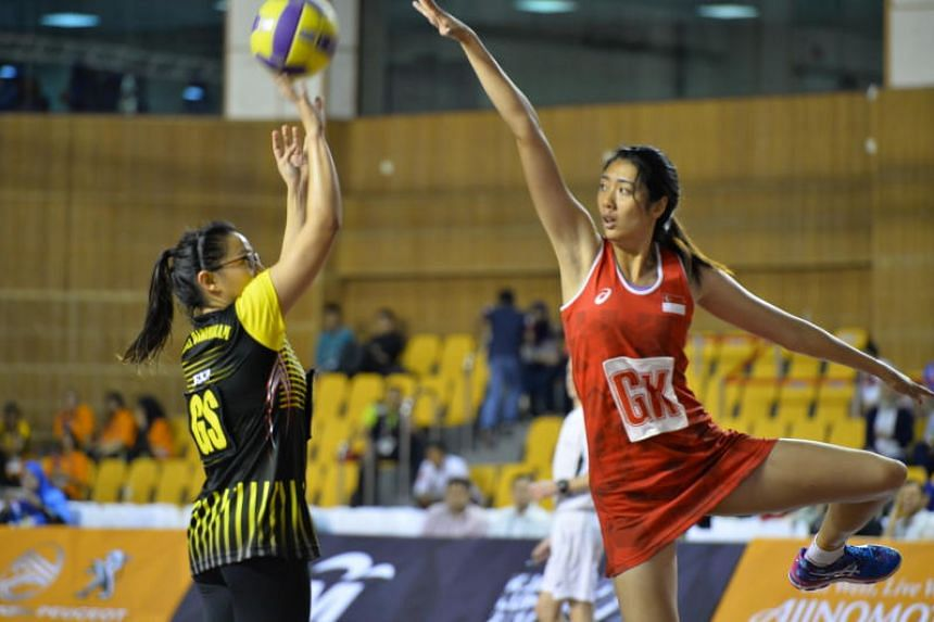 Defensive player Chen Lili (right) had been on a six-month injury layoff after tearing her anterior cruciate ligament during last year's Mission Foods Nations Cup.
