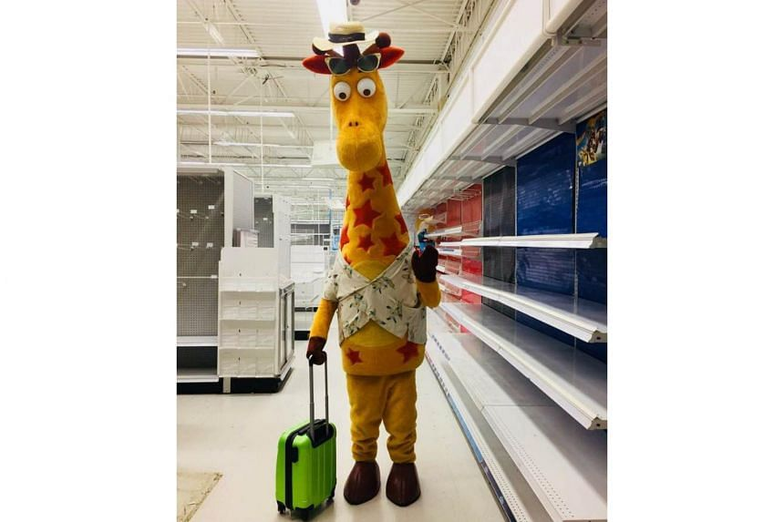 Toys 'R' Us mascot Geoffrey the Giraffe leaving an empty store in the United States, after the company closed all of its stores in the country on June 29, 2018.