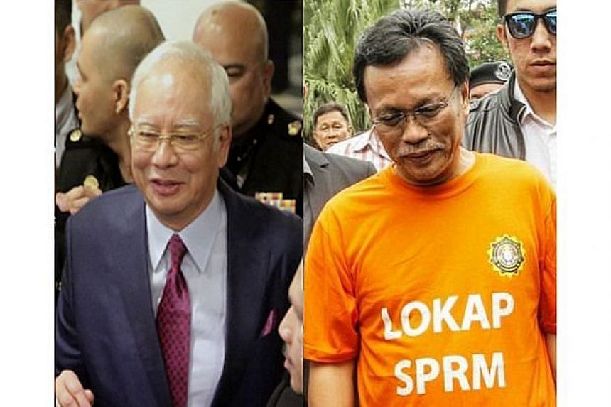 """Former Malaysian prime minister Najib Razak (left) was not wearing the Malaysia Anti Corruption Commission's infamous orange lock-up T-shirt """"uniform"""" when he appeared at the Kuala Lumpur High Court on July 4, 2018."""