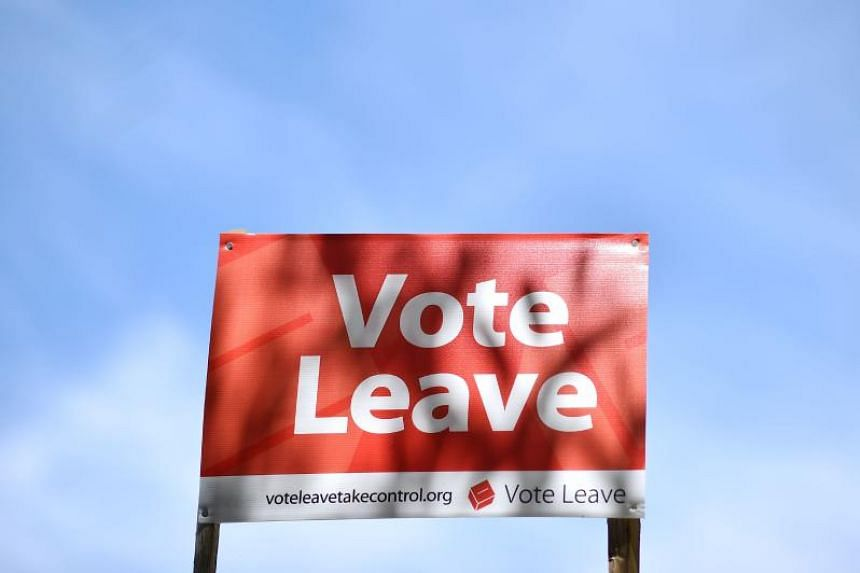 A sign urging people to vote for Brexit in the EU referendum is seen on the roadside near Charing, south east of London, on June 16, 2016.