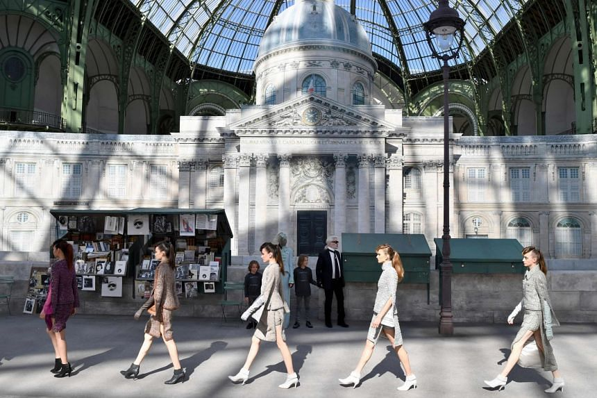 Models present creations by Chanel during the 2018-2019 Fall/Winter Haute Couture collection fashion show.