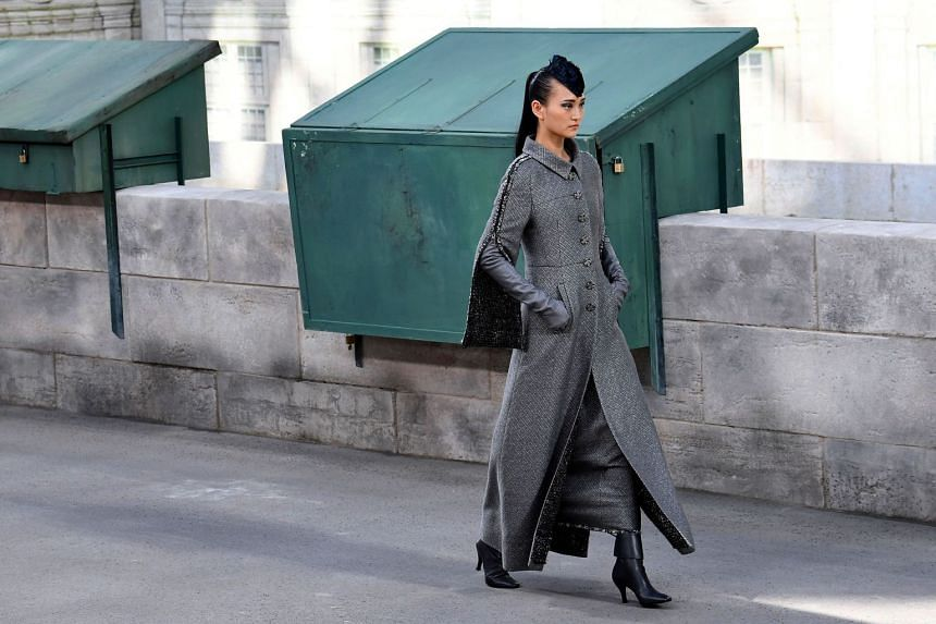 A model presents a creation by Chanel during the 2018-2019 Fall/Winter Haute Couture collection fashion show.