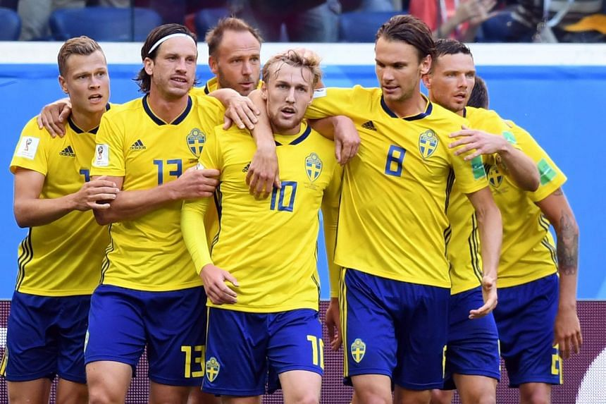 Sweden's midfielder Emil Forsberg (centre) celebrates with team mates (from left) John Guidetti, Gustav Svensson and Albin Ekdal after scoring.
