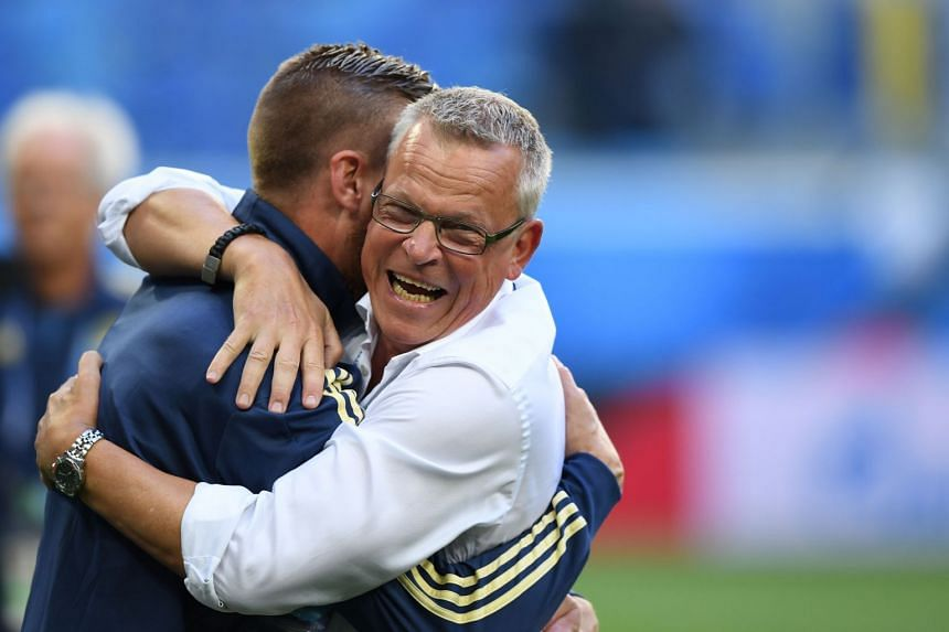 Sweden's coach Janne Andersson (right) and defender Pontus Jansson celebrate their victory.