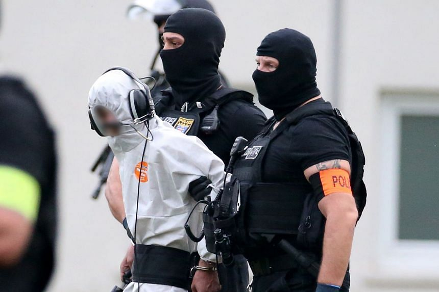 Bashar is escorted to a helicopter by police after testifying in Wiesbaden, western Germany, in June 2018.