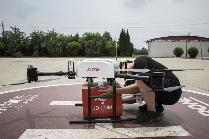 An employee prepares a JD.com Inc. drone during a package delivery demonstration at a launch pad of the company's drone testing site in Xi'an, China, on June 19, 2018.