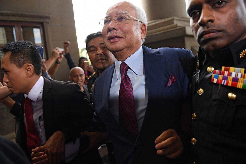 Former Malaysian prime minister Najib Razak (centre) arrives in court in Kuala Lumpur, Malaysia, on July 4, 2018.