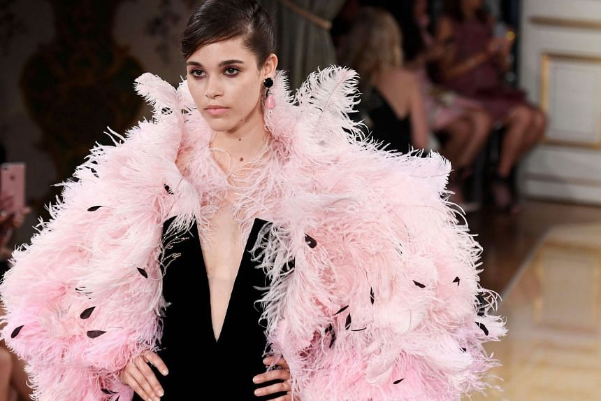 A model presents a creation by Giorgio Armani during the 2018-2019 Fall/Winter Haute Couture collection fashion show in Paris, on July 3, 2018.