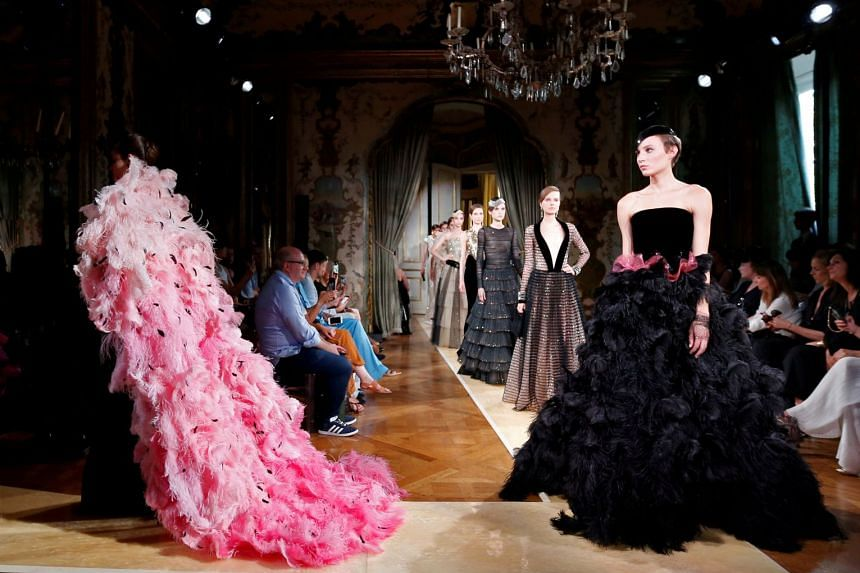 Models present creations by Giorgio Armani at the end of the 2018-2019 Fall/Winter Haute Couture collection fashion show in Paris, on July 3, 2018.