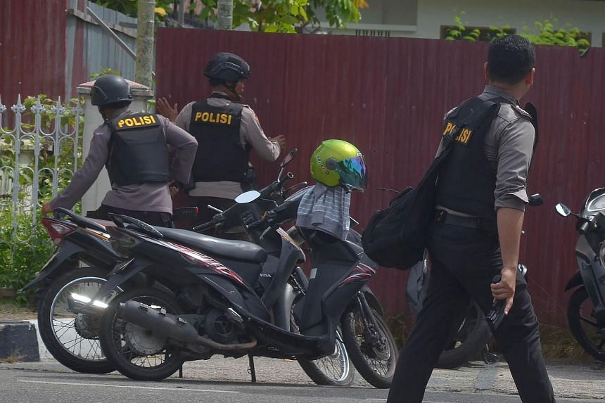 File photo showing Indonesian policemen responding to an incident in Riau, Indonesia, on May 16, 2018.