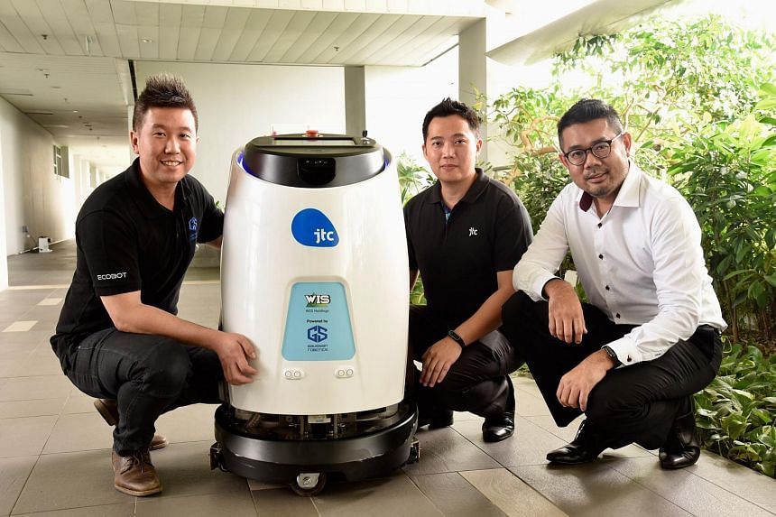 From left: Mr Aloysius Chong, director of Gaussian Robotics, Mr Jason Foo, director of the building management division of JTC, and Mr Kelvin Lee, chief commercial officer of WIS holdings, posing with Scrub 50.